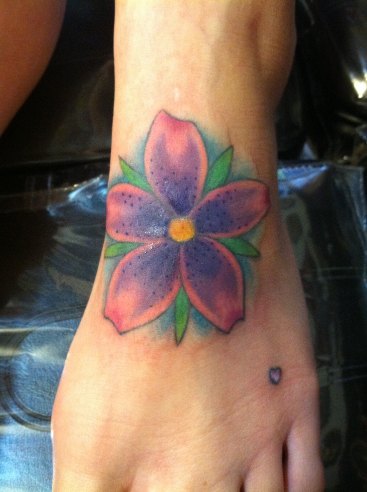 Foot tattoo flower cherryblossom cute painful bright for How sore is a tattoo on your foot