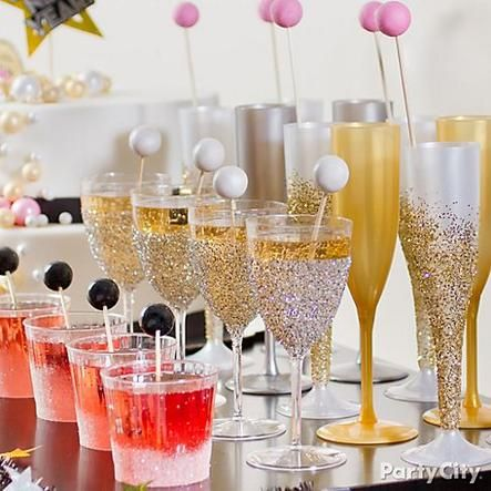 Glitterbomb your cocktail glasses! Toast the New Year with glittery glasses and gumball swizzle sticks. Click for more glitzy New Year's Eve party ideas!