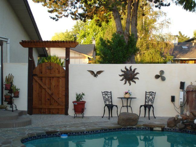 Stucco wall with gate and arbor stucco walls for Stucco garden wall designs