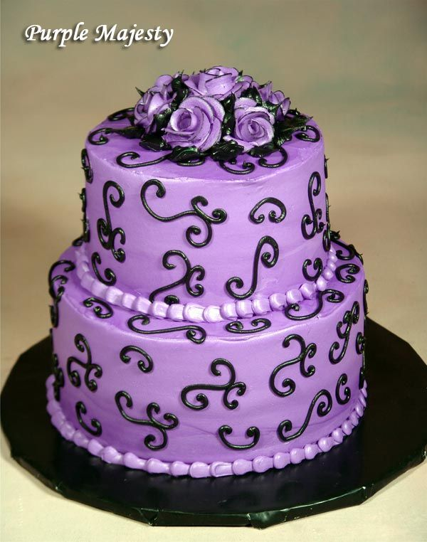Change this to a white cake with blue swirlies with orange and yellow flowers up top