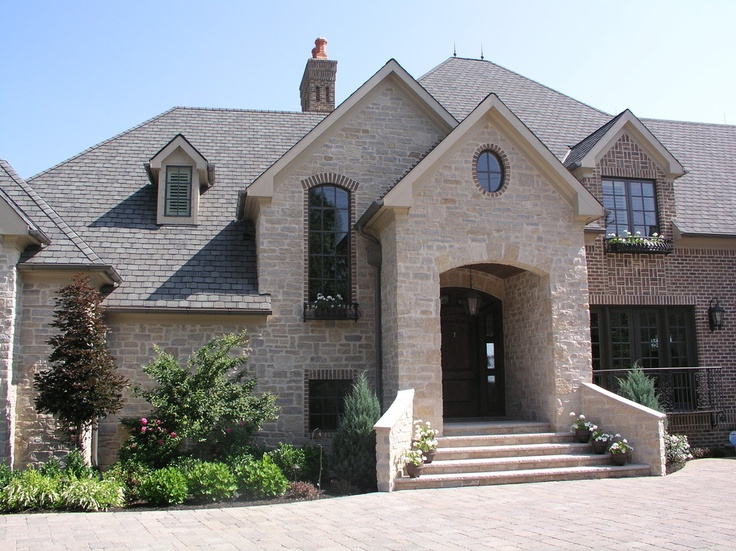I like the stone and brick accents dream house for Houses with stone accents