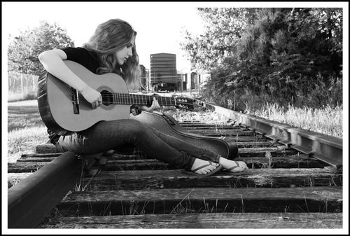 My cousin's daughter playing her guitar.  Senior portrait.