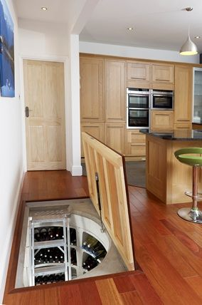 Trap door spiral wine cellar at home pinterest - Wine cellar trap door ...