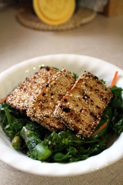 Grilled sesame tofu over spinach, asparagus, and snap pea salad.
