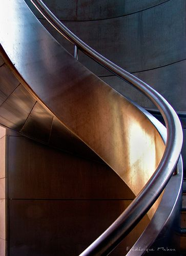 The spiral of the stairs looks smooth There are no sharp edges. I'd love to run down these Christmas Morning!  #christmas #modern #architecture #cool #stairs  www.modernchristmastrees.com