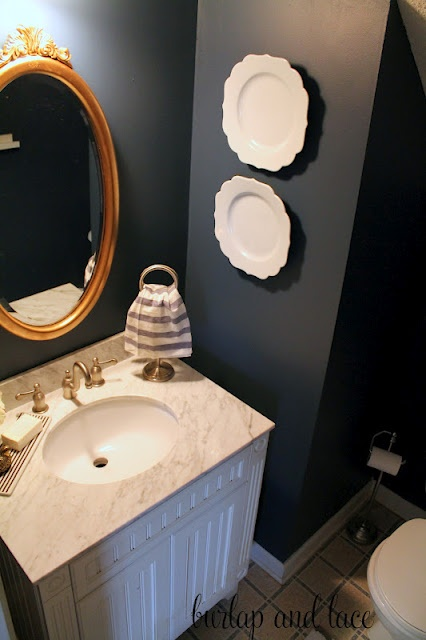 Navy bathroom and accompanying sink and tile.