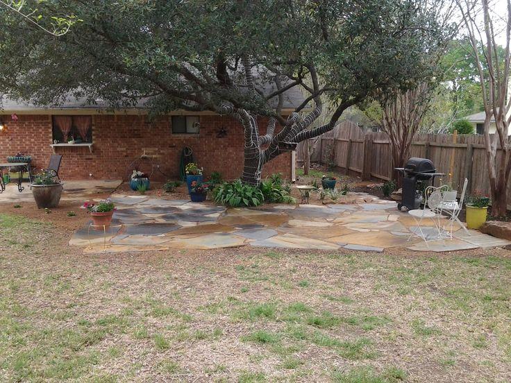 Backyard landscape de posed granite patio underneath