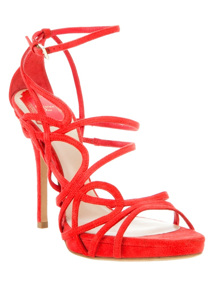 Red suede sandal from Dior featuring an open toe, multiple suede strap details, a leather sole, a suede covered stiletto heel and an ankle strap with a gold-tone buckle fastening.