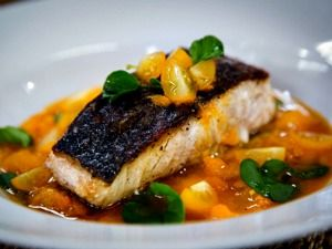Striped Bass With Golden Tomato & Sweet Pepper Stew