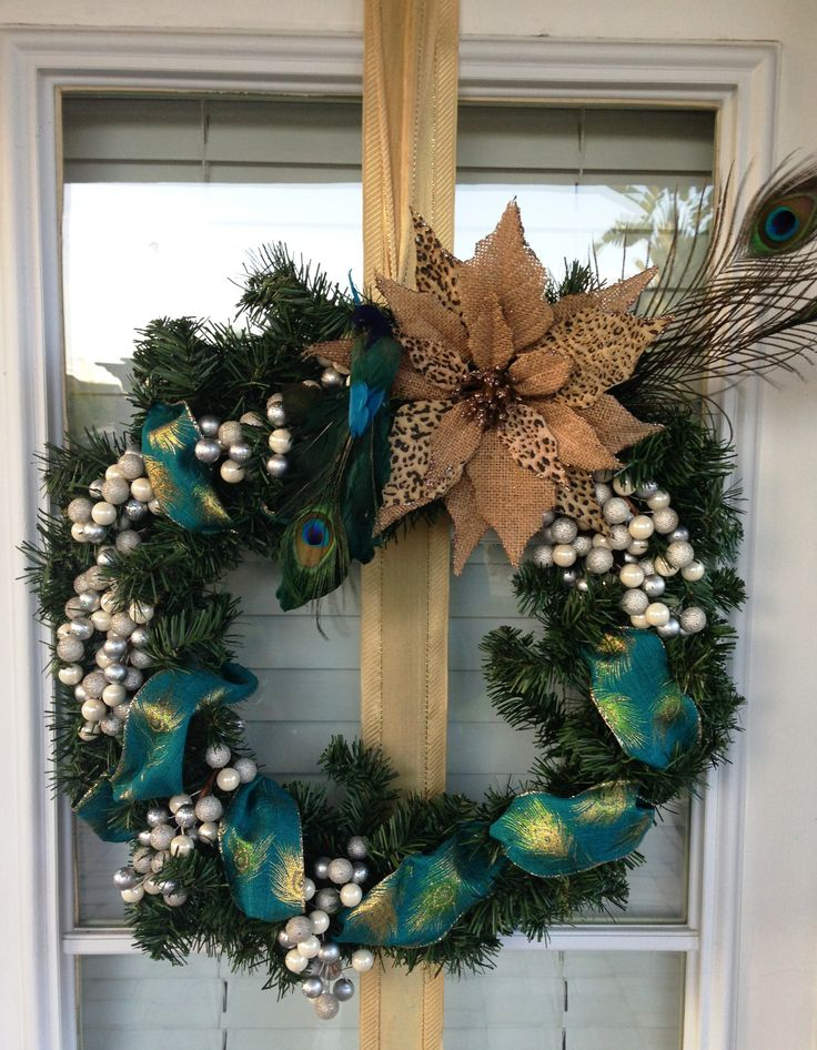Creative Wreath using Peacock Blue Color scheme. Made by Living Design Interiors