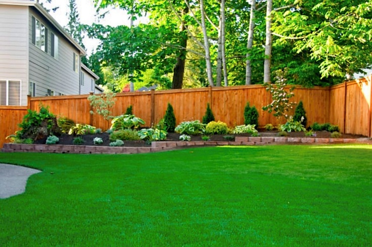 Great idea for flower bed along our back fence green thumb for Flower bed fencing