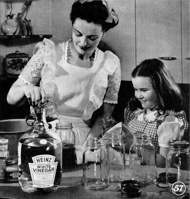 Canning with mom, 1945 - I used to love canning with my mother when I was a little girl. #vintage #mom #daughter #kitchen #apron #canning #1940s #food #WW2