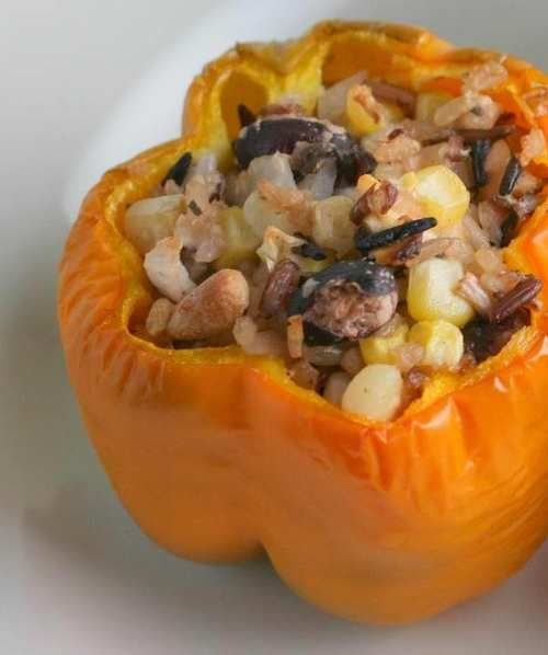 Bell peppers stuffed with wild rice, pinto beans, corn and feta cheese ...