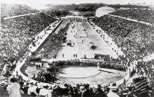 The first Olympic games of modern era - 1896 Athens, Greece. 1894 first modern Olympic Games held in event's historical home – Greek capital, Athens. The Panathinaiko Stadium attracted what at the time were largest crowds in sporting history but, despite perceived success of 1896 games, event didn't return to Athens until 2004 –100 years later. Fortunately Spyridon Louis a mere water carrier, won the first modern Olympic marathon, giving the Greeks a hero to see them through the 20th century.