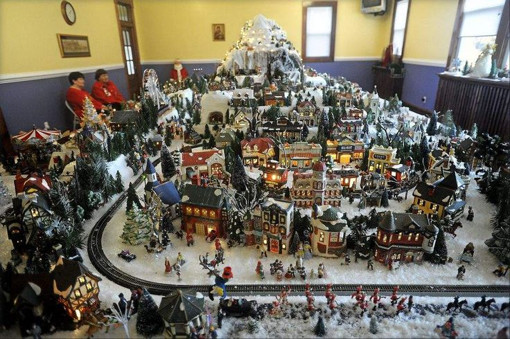 Staff photo by REID SILVERMAN The Christmas village created by ...