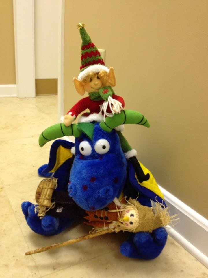 elf on the shelf is one up on the poor scarecrow today with a little ...