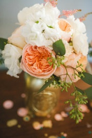 Peach and white flowers in gold vases (but we will use mint juleps instead of mason jars).