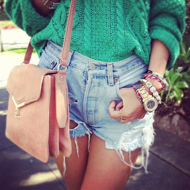 baggy sweater, ripped shorts, stacked bracelets. genius.