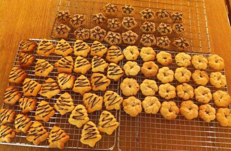 Christmas spritz biscuits made with cookie dough press; ginger ...