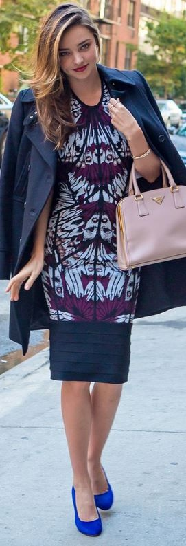 Who made Miranda Kerr's pink handbag, blue coat, suede pumps, and purple print dress?
