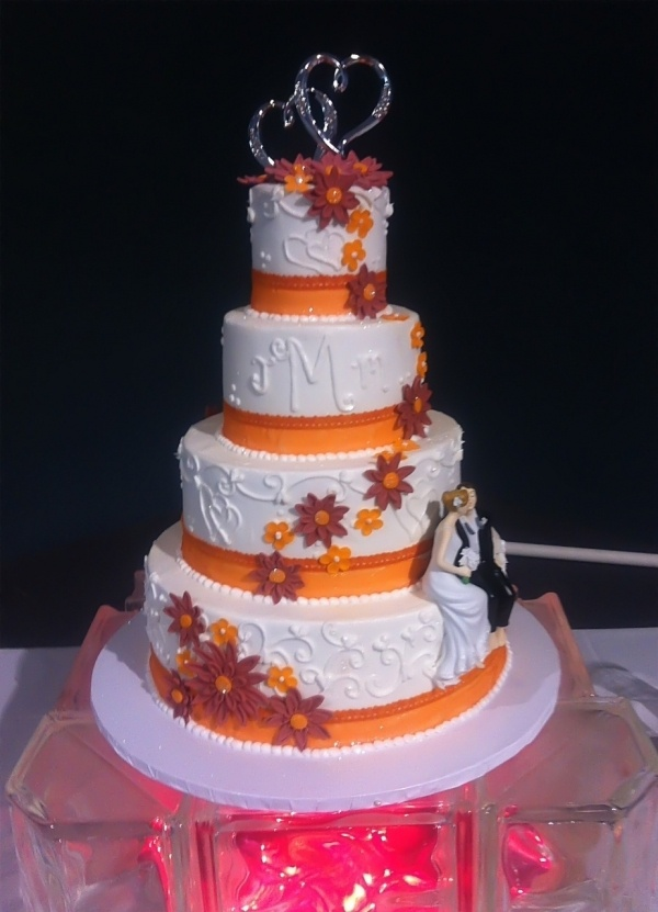 Pink & Orange Wedding Cake....with out the pink would be great