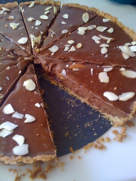 Chocolate, Ricotta tart w/ dried cranberries and almonds.