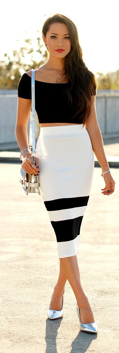 Imagine shirt tucked into skirt, with a white blazer and black heels. YES.