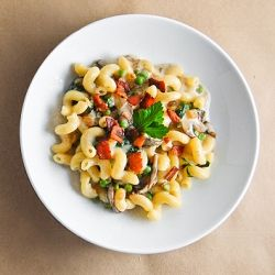 Easy, creamy cavatappi with spinach, mushrooms, peas and bacon.