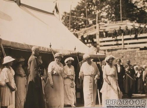 Grand Duchesses Olga and Tatiana attend the dedication of a girls' school with their mother, c. 1915.