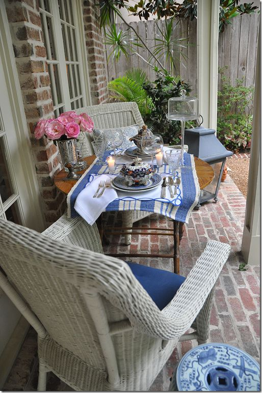 love the blue and white striped rag rug used as a table runner