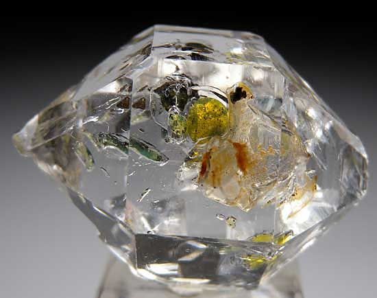 Here's something you don't see everyday, fellow rock lovers. . . quartz with oil inclusions. In fact I've never seen it. Really amazing.