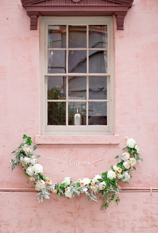 Pink paint and a floral garland... gorgeous!