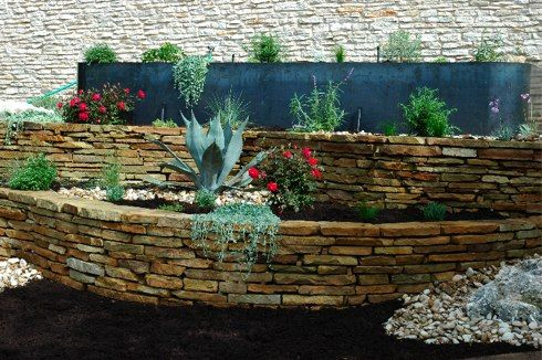 Tiered retaining wall retaining walls pinterest for Flower bed wall designs