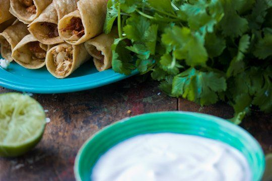 Chicken flautas with lime sour cream. Will probably bake the flautas ...