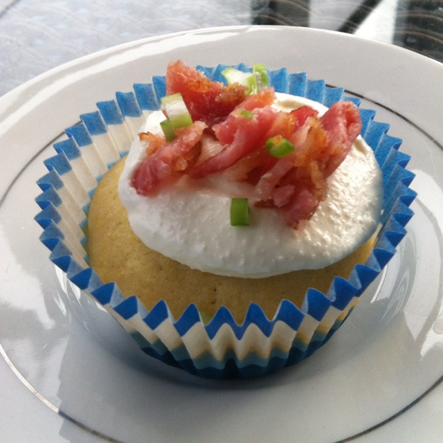 """Savory corn muffin with goat cheese """"frosting,"""" bacon and scallions..."""