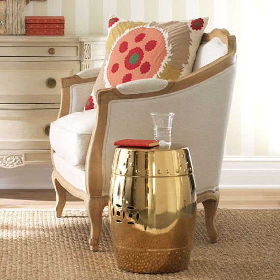 Spearmint Decor found this gold Chinese garden stool to add some zing to her living space!