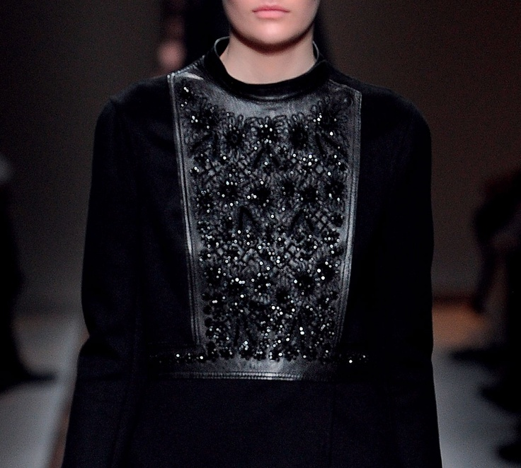 An unexpected combo of leather and lace embroidery from Valentino
