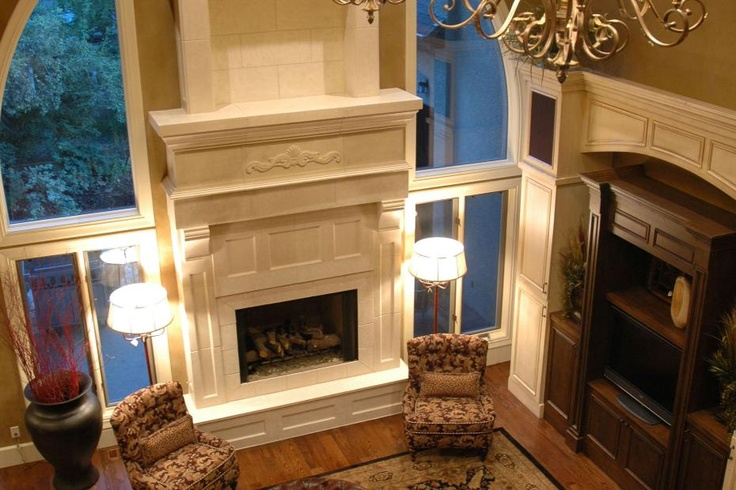 Stunning Grand Fireplace In A Tuscan Style Living Room
