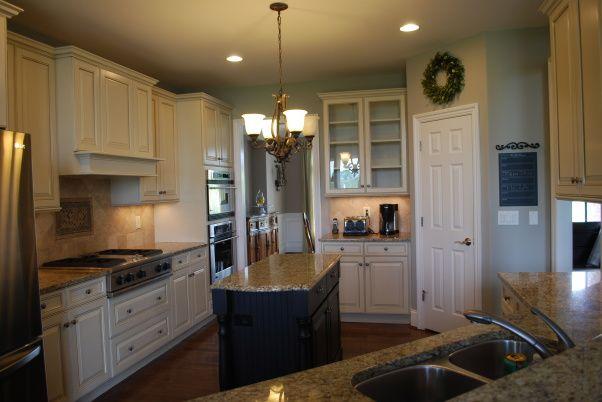 Dark island, cream cabinets  Kitchen Pinterest