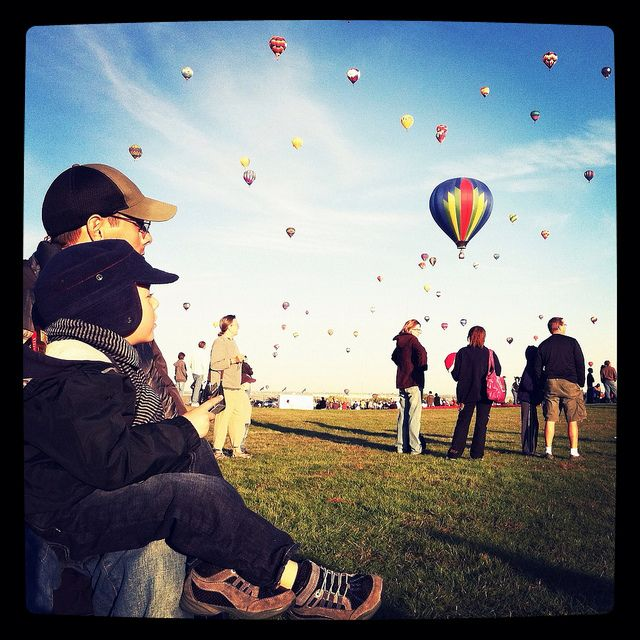 Uncle & nephew bonding under balloon fiesta. by sarah cakes, via Flickr