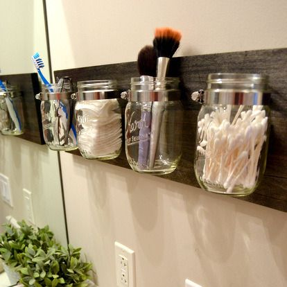How-To: Mason Jar Bathroom Organizer. I love this idea, only thing I would change is I would use metallic spray paint to have them match my bathroom colors.