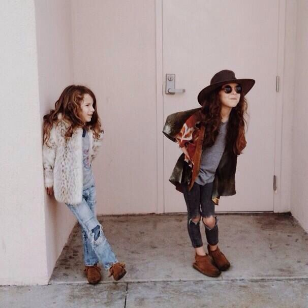 Bohemian stylish kids in torn jeans, moccasins & oversized sweaters. Adorable!