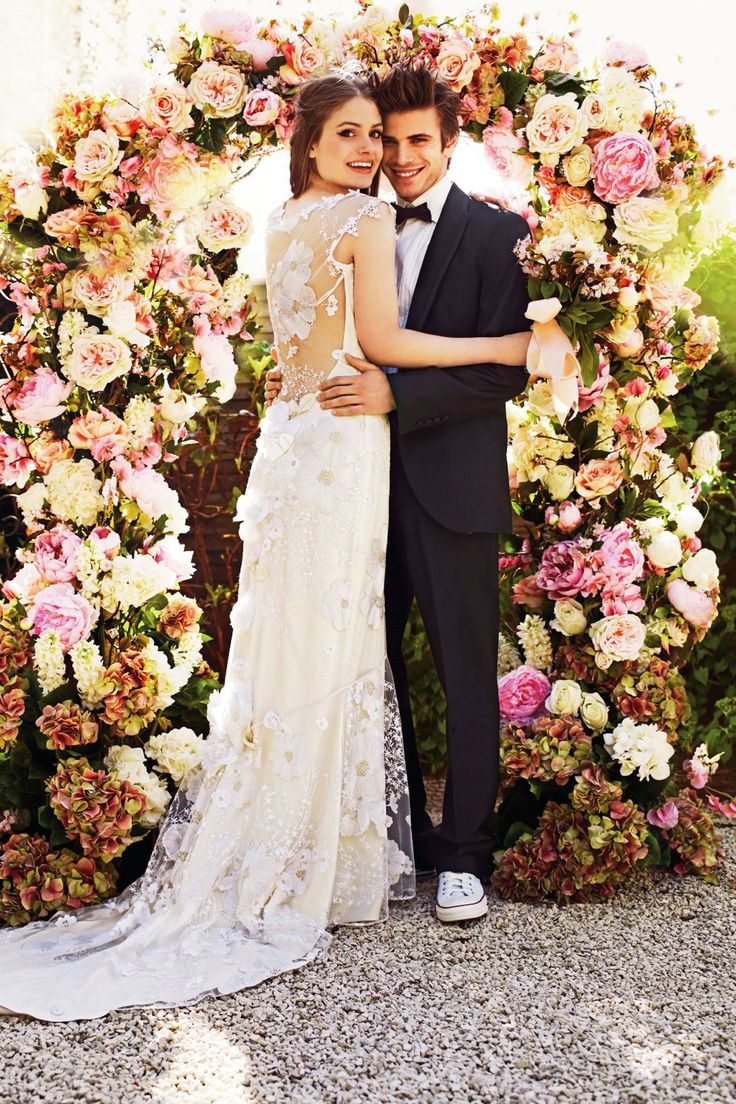 bride and groom in floral bower