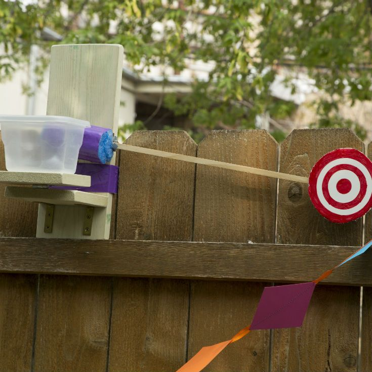 """Throw a science-themed carnival this summer! Build this dunk bucket for a """"cool"""" lesson about the center of mass."""