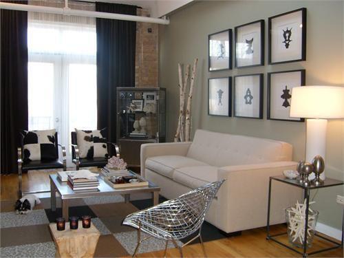 Suzie: HGTV - Modern living space! ivory gray modern sofa, black glass top end table, FLOR ...