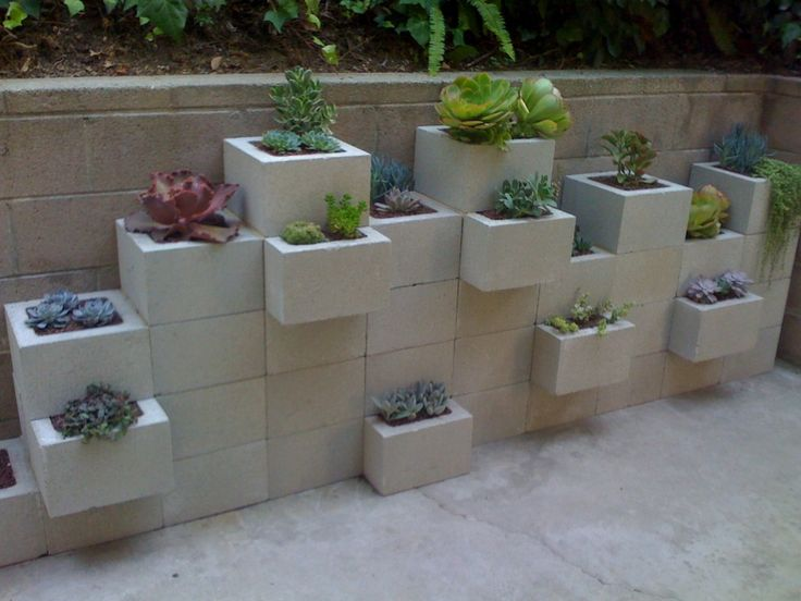 Cinder Block Wall Planters Flowers Wind Chimes Outside