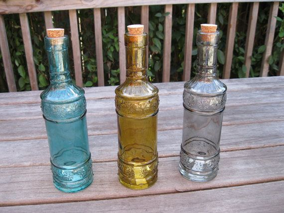 Three embossed decorative colored 9 glass bottles with for Colored glass bottles with corks