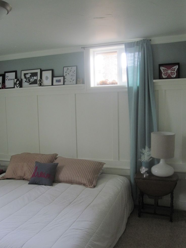 small basement window with full length curtains