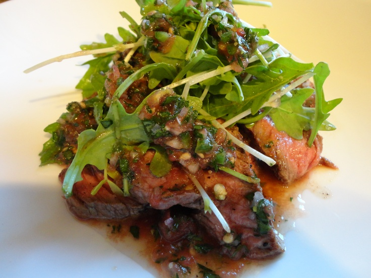 deliciousness: thinly-sliced grilled steak, topped with arugula ...