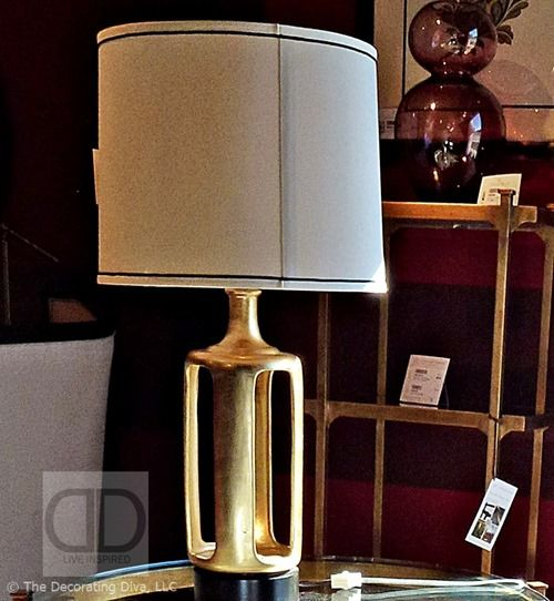 Tailored and sophisticated symmetry with a nod to mid-century style define this glam brass table lamp sighted at the Jonathan Charles showroom.  Sculpted Gold Base Table Lamp Jonathan Charles Fine Furniture | The Decorating Diva,LLC  #HPMKT